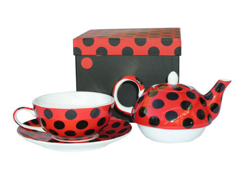 Teapot and mug for one person with black polka dots and red background